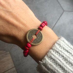 Red good luck coin bracelet